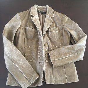 Sandra Angelozzi distresses leather jacket